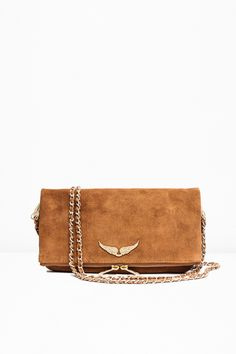 """Zadig & Voltaire zipped clutch, two removable metal chains interlaced with suede leather, can be worn cross body or on the shoulder, large rhinestone winged rivet, D3cm/1.25"""", H18cm/7"""", L27cm/10.75"""", 100% leather. This model is the Zadig & Voltaire iconic clutch, redesigned every season. It matches with different outfits : worn on the shoulder for a dressy look, shoulder bag for a casul look, or without chains for a night out style."""