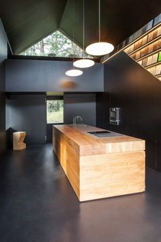 Atelier Kitchen Haidacher / Lukas Mayr Architekt black room, plywood island block by carol.hasky