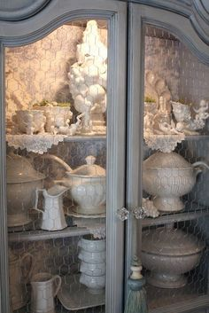 So French Country! Love the toile, the whiteware and chicken wire on the doors! (Makeover idea for old china cabinets...).