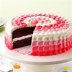Cake with Buttercream Decorating Frosting Recipe -This sweet creamy frosting made with real butter is easy to blend together and holds its shape nicely when used to decorate a special layer cake. —Taste of Home Test Kitchen