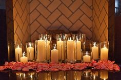 Love the candles in the fireplace... do this for  the reception if at church, if there's a fireplace at another location