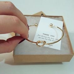 BRIDESMAID Gift Knot Infinity Bracelet Gold Infinity bracelet, perfect for saying Thank You to someone special on your wedding day. Mother of Bride, Maid of Honor, Bridesmaids, Sister, Friend. Gift wrapped in a triangle stamped VISP bracelet box ready to gift. Special pricing for multiples. You can also buy just the boxes with custom cards, or the bracelets without the special packaging. Minimalist Jewelry Co Jewelry Bracelets