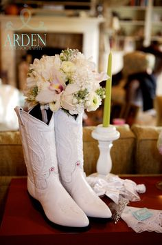 Bridal Bouquet of creams with Orchids splash of pale pink in cowboy boots the bride wore.