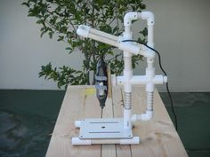 "Pictures of a ""build it yourself"" PVC Drill Press. No plans on site, but you can contact the builder."