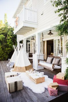 Love the mini balcony; and the open area below the upper structure, creates a covered porch!