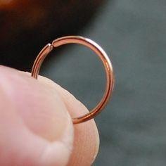Gold Nose Ring - 18 Gauge SOLID Rose Pink Gold Seamless / Catchless Nose Ring. $32.95, via Etsy.