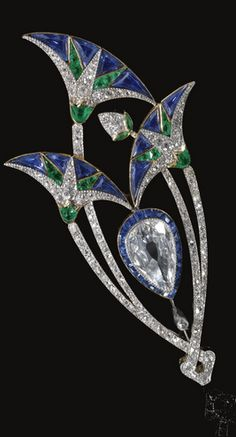 EMERALD, SAPPHIRE AND DIAMOND BROOCH, BOUCHERON, CIRCA 1920 Designed as a stylised lotus flower, embellished with millegrain set rose, pear-shaped, single- and circular-cut diamonds, and calibré-cut sapphires and emeralds, signed Boucheron Paris and indistinctly numbered, French assay and maker's marks.