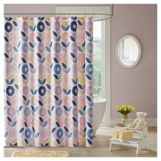 Beauty and color will flourish in your space with the Polly Shower Curtain. A floral pattern in a lovely palette of peach, blue, and yellow is printed on a white ground. Machine washable for easy care, this cotton shower curtain is sure to liven up your bathroom.