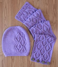 Free Knitting Pattern for Idyll Hat and Cowl Set - Flowing lace pattern on matching beanie hat and buttoned neckwarmer. Designed by Universal Yarn Design Team. Quick knit in bulky yarn.
