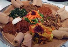 Head to this Ethiopian restaurant decorated with eye-catching African decor and art. Eat like you're in Ethiopia - with your hands! Ethiopian Restaurant, Cultural Experience, Foodie Travel, Food And Drink, Beef, Ox, Steak
