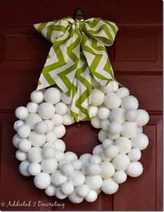Snowball wreath:  coat styrofoam balls with modge podge and roll in epsom salts. let them dry, stick a toothpick in the back and stick them into a foam wreath form.