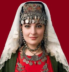 Armenian woman wearing traditional head decoration and silver jewelry