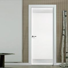 The beautiful prefinished San Rafael Lacada 921 FD30 Fire Door with groove designs. #lacadadoors