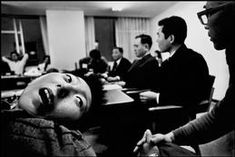 photo by  Eugene Smith: JAPAN. Minamata Bay. Tomoko UEMURA, a victim of mercury poisoning, is taken to the Central Pollution Board, during the Victims of the Minamata Diseas versus the Chisso Chemical Plant trial. The patients demanded that the members of the Board look, touch, and hold him. 1971.