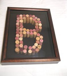 """Gift idea: Guest signatures/messages surrounding """"J"""" in corks, mounted inside a shadow box."""