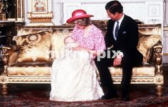 August 4, 1982: Prince Charles  Princess Diana holding Prince William at Buckingham Palace after his Christening.