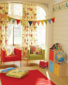 Fun sitting corner in a children's playroom or bedroom. Bunting, brightly-coloured chairs, fun pillows and curtains.
