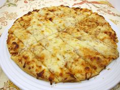 1/4 cup butter, softened  1 tsp minced garlic  1 cup mozzarella cheese, shredded  1 Boboli original pizza crust  1-2 tsp honey  Preheat oven to 450.  Bake 10-15 minutes,