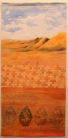 Desert Quilt by Jenny Bowker - she does fabulous quilts with life like images offset by blocks ... look for her website.