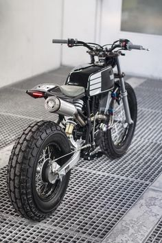"""Rear 3/4 view """"Fat Tracker"""" built by Wolf Moto."""