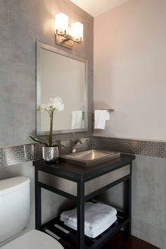 Modern Powder Room with Powder room, Console sink, Glazed porcelain floor and wall tile, Stainless steel sink
