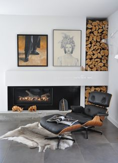 Lounging in luxury: Eames chair, hide rug, fireplace, built in wood storage and artwork. The perfect reading corner