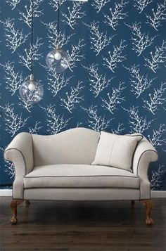 Temporary Wallpaper -- might be a great way to add an accent wall to an unfinished basement. Just have to paint and prime the cement wall first.