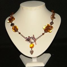 Asymmetrical copper necklace with bronze amber lampwork beads and Lily clasp