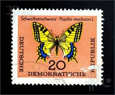 Butterfly Postage Stamps | ... republic - CIRCA 1980: butterfly on old canceled postage stamp