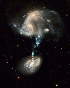 A Hubble space telescope image of Arp 194, interacting galaxies in the constellation of Ursa Major (The Big Dipper)