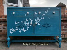 teal turquoise painted sideboard. Vintage furniture. Shabby chic mouldings. White ceramic roses knobs. Hand cut white paper butterflies. Decoupage. Shabby chic distressed chalk paint