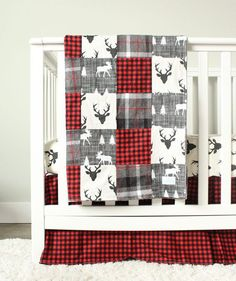 Lumberjack Woodlands Crib Bedding Three Piece Set includes - Blanket Crib Skirt Crib Sheet **** Crib Skirt - 14 drop, center pleat - Red Plaid Crib Sheet - Standard size, fitted - Black buck head Patchwork Blanket - 34 x 49 backed with gray minky - gray windowpane flannel, gray