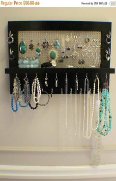 ***This is a MADE TO ORDER listing. You will receive a jewelry organizer the same as the one pictured above but this one already has a home.***** This listing is for a wall mounted jewelry organizer just like the one pictured above. There is plenty of room for all you jewelry storage