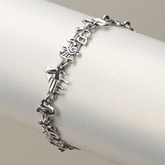 Music you can wear every day. Pianos, saxophones and bars of music in fluid, contemporary shapes link together to form this delightful bracelet. Lead and nickel free bracelet measures 8' long.