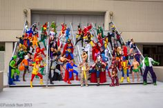 """Cosplay a-go-go!!  The """"Justice League"""" on the left vs. the """"Avengers"""" on the right, as tribute to George Perez (front & center with Large Pencil) and the now-decade-plus old JLA/AVENGERS limited series.  For you newbies, cosplay is an inescapable part of events like Dragon*Con, like extra cheese on a pizza.    -- Photo by a Patrick Sun (though there are lots by Pat Loika as well);   -- JLA © DC Comics [& Time Warner], while the Avengers © Marvel Comics/Entertainment [& later Disney, I…"""