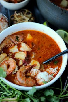 Buttery Brazilian Fish Stew - how to make moqueca. A seafood stew that is hearty and savory.  Perfect winter comfort food.  thewoodenskillet.com