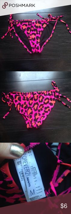 Forever 21 swim suit bottoms! Never worn! NWOT NWOT never worn!! Cheetah print!! Tag says M but could fit S easily. Looks more like a small to me!! Forever 21 Swim Bikinis