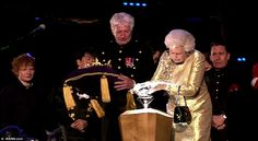 Momentous: The Queen lights the final Jubilee Torch as singer Ed Sheeran and musician Jools Holland look on. The small Pacific island of Tonga claimed the honour of lighting the first of 4,150 Jubilee beacons which are being lit around the world