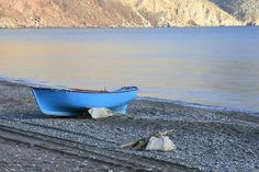 a blue wooden boat on a beach in Tilos, Dodecanese, Greece Wooden Boats, Sandy Beaches, Ancient Greece, Greece Travel, Crete, Beautiful Islands, Greek Islands, World Heritage Sites, Santorini