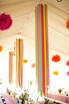 These streamer chandeliers are great for high ceilings or the outdoors. To make them, cut strips of crepe paper to varying lengths. Attach them to a circular ring and then attach the ring to the ceiling.