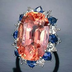 """This 30 carat pinkish-orange sapphire is known as a """"padparadscha"""" sapphire and is one of the rarest and most prized of all sapphires...it's name comes from the Singhalese word for salmon coloured lotus blossom! #sapphire #jewelry #diamond #gemstone #gorgeous #getstoned #ringporn #mrsortonsinstaglam"""