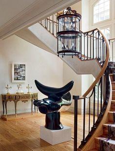 Modern Elegance : Architectural Digest. Modern sculpture acts as statement piece below magnificent spiral staircase.