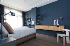 Blauw en grijs voeren de boventoon in dit interieur roomed