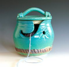 KittyProof Yarn Bowl. Would also keep yarn from rolling onto the floor and unraveling!