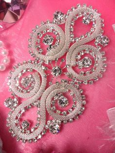 Silver Crystal Clear Rhinestone Applique Embellishment Silver Crystal Clear Rhinestone Applique Embellishment Size: x This is a new arrival very similar to our This one has a little different design in the center. Very lovely applique with all glass Embroidery On Clothes, Beaded Embroidery, Hand Embroidery, Embroidery Designs, Fabric Embellishment, Embellishments, Etsy Fabric, Techniques Couture, Rhinestone Appliques