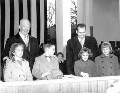1957 - Dwight Eisenhower and Richard Nixon watching inaugural parade with Anne & David Eisenhower and Julie & Tricia Nixon""