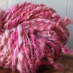 Mohair and merino, hand spun and dyed with pokeweed