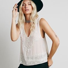 Free People Embellished Tank Brand new with tags. Gorgeous Free People high/low beaded embellished tank. Color: Champagne. Size S. Retail $128.  Listed elsewhere as well. Free People Tops Tank Tops