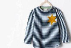 Una semplice maglietta a righe per bambini, con unico dettaglio: una stella gialla a sei punte che voleva rendere omaggio agli sceriffi del West. Una scelta stilistica, quella di Zara, che a molti ha invece ricordato le divise fatte indossare agli ebrei nei lager. E che ha scatenato la polemica sul web, costringendo il brand al dietrofront.