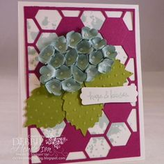 The Pretty Paper Punch Hydrangea Card balances elegance and fun with bright blue paper flowers and a pink honeycomb cutout in the background. This tutorial will help you learn how to make paper flowers to embellish your handmade card ideas.